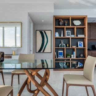 Réalisation d'une grand salle à manger ouverte sur la cuisine design avec un mur blanc et un sol turquoise.