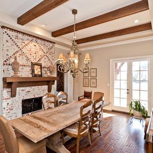 Idee per una sala da pranzo classica con pareti beige, parquet scuro, camino classico e cornice del camino in mattoni