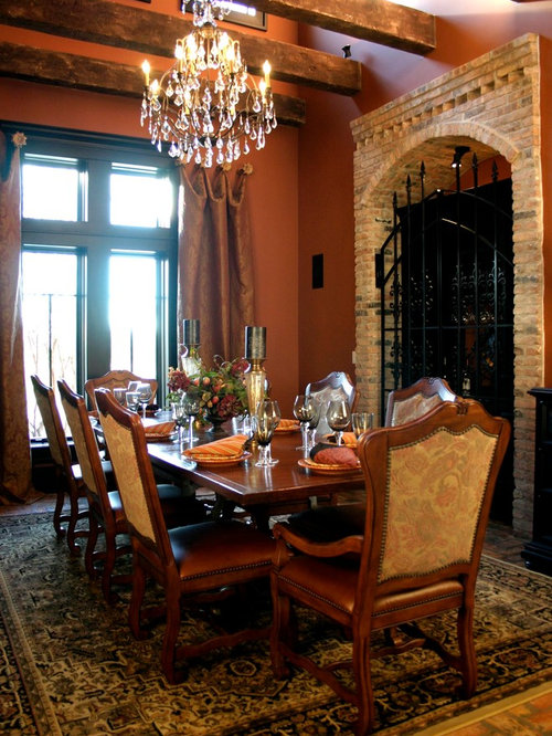 Best dining room with brick floors and orange walls design for Deycon piscinas