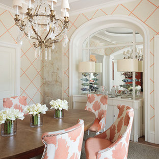 Transitional medium tone wood floor enclosed dining room photo in Miami with multicolored walls