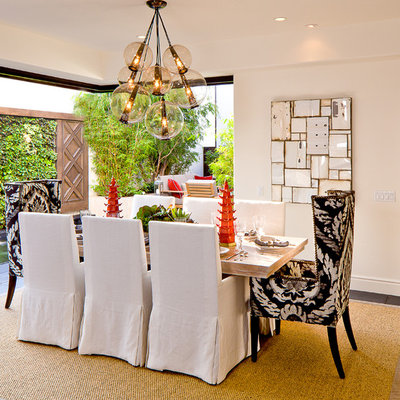 Inspiration for a mid-sized mediterranean slate floor dining room remodel in Orange County with white walls and no fireplace