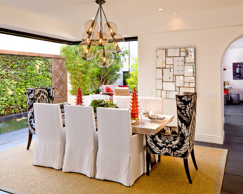 Inspiration For A Mid Sized Mediterranean Slate Floor Dining Room Remodel  In Orange County With