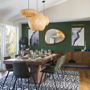 Kitchen/dining room combo - large mid-century modern medium tone wood floor and brown floor kitchen/dining room combo idea in Denver with green walls