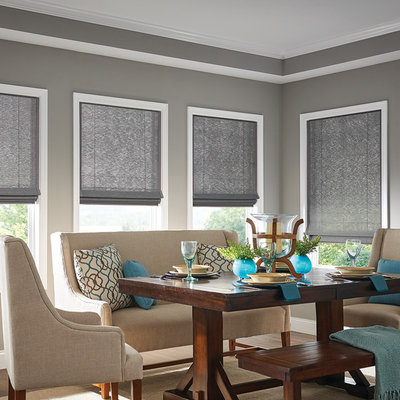 Example of a mid-sized transitional dark wood floor and brown floor enclosed dining room design in Other with gray walls and no fireplace