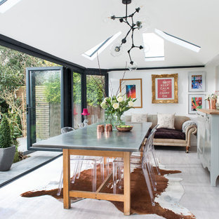 Inspiration for a medium sized eclectic dining room in Hertfordshire with white walls and grey floors.