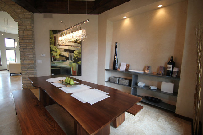 Contemporary Dining Room by Jerry Bussanmas