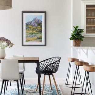 Kitchen/dining room combo - transitional gray floor kitchen/dining room combo idea in Austin with gray walls
