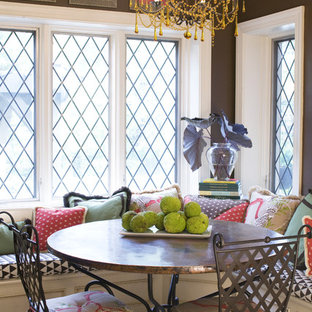 Dining room - traditional dining room idea in St Louis with brown walls