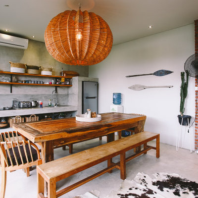 Eclectic concrete floor and gray floor great room photo in Singapore with gray walls