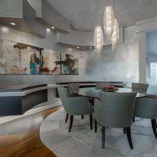 Trendy dark wood floor dining room photo in Miami