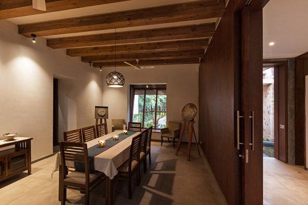 Contemporary Dining Room by Kumar Moorthy & Associates