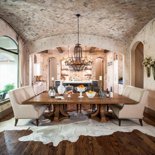 Kitchen/dining room combo - mid-sized rustic medium tone wood floor and brown floor kitchen/dining room combo idea in Houston with beige walls and no fireplace