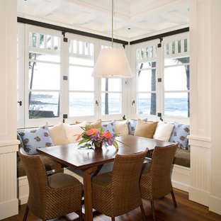 Design ideas for a nautical dining room in San Francisco with dark hardwood flooring and brown floors.