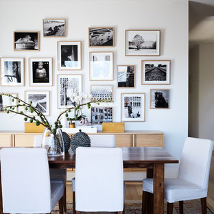 Inspiration for a transitional dining room in Melbourne with white walls, light hardwood floors and brown floor.