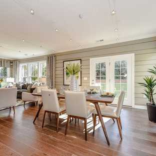 Design ideas for a mid-sized tropical open plan dining in Charlotte with medium hardwood floors, beige walls and no fireplace.