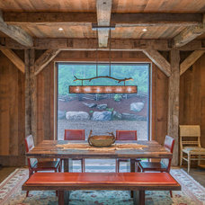 Rustic Dining Room by RMT Architects