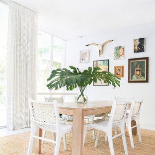 Trendy dining room photo in New York with white walls