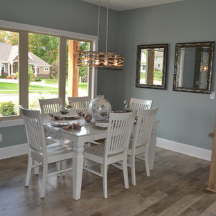 Mid Sized Transitional Vinyl Floor And Beige Great Room Photo In Cleveland With Gray