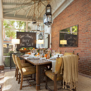 Example of a mountain style brick floor dining room design in Philadelphia