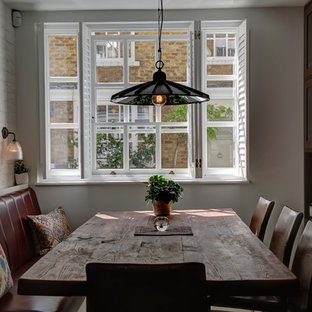 Classic kitchen/dining room in London with white walls.