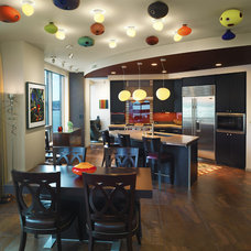 Contemporary Dining Room by Wascha Studios