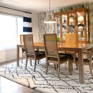 Kitchen/dining room combo - mid-sized mid-century modern laminate floor and brown floor kitchen/dining room combo idea in Other with white walls