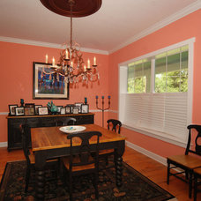 Tropical Dining Room by Javic Homes