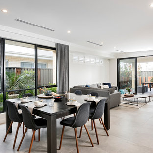 This is an example of a contemporary open plan dining in Perth with ceramic floors and white walls.