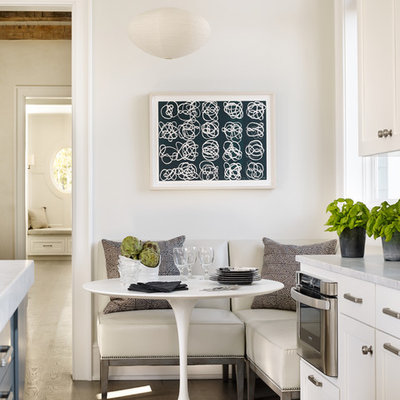 Example of a beach style medium tone wood floor dining room design in Atlanta with white walls