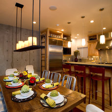 Industrial Dining Room by area design, llc.
