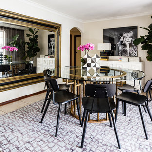 This is an example of an eclectic separate dining room in Perth with beige walls and beige floor.