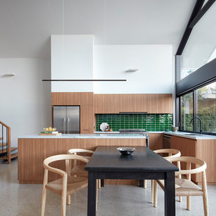 Photo of a mid-sized contemporary kitchen/dining combo in Melbourne with white walls, concrete floors and grey floor.