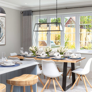 Photo of a medium sized farmhouse kitchen/dining room in Berkshire with grey walls and grey floors.