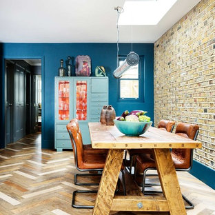 Design ideas for a classic dining room in London with blue walls, medium hardwood flooring and beige floors.