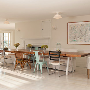 Kitchen/dining room combo - large farmhouse light wood floor and white floor kitchen/dining room combo idea in Providence with white walls, a standard fireplace and a plaster fireplace