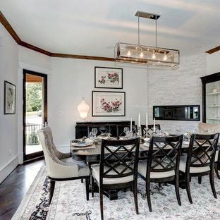 Foto di una sala da pranzo aperta verso il soggiorno classica di medie dimensioni con pareti bianche, parquet scuro, camino lineare Ribbon e cornice del camino in pietra