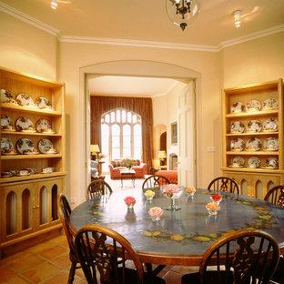 Example of a classic terra-cotta floor dining room design in London