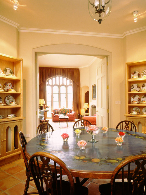 Example of a classic terra cotta floor dining room design in London. Painted Dining Tables   Houzz