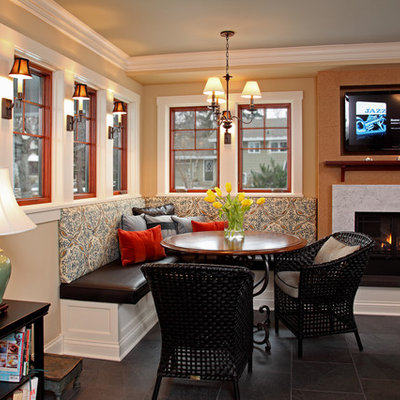 Inspiration for a timeless dining room remodel in Minneapolis with beige walls and a standard fireplace