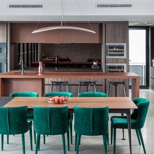 This is an example of a mid-sized contemporary open plan dining in Perth with white walls, concrete floors and grey floor.