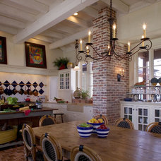 eclectic dining room by Eric Watson Architect, P.A.