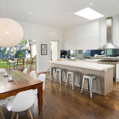 Large trendy dark wood floor great room photo in Melbourne with white walls and no fireplace