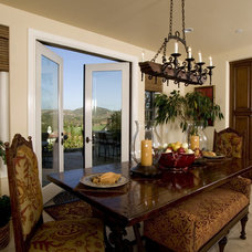 Mediterranean Dining Room by Todd Peddicord Designs