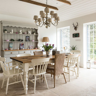 Dining room - large cottage ceramic floor dining room idea in London