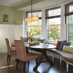 Example of a classic dark wood floor kitchen/dining room combo design in Boston with brown walls, a standard fireplace and a tile fireplace
