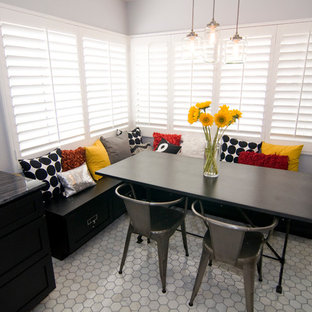 Example of a classic dining room design in Orange County with gray walls