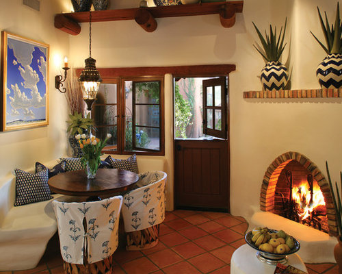 Dining Room   Southwestern Terra Cotta Floor Dining Room Idea In Phoenix  With Beige Walls