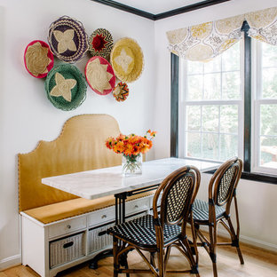 Kitchen/dining room combo - small eclectic light wood floor kitchen/dining room combo idea in DC Metro with white walls