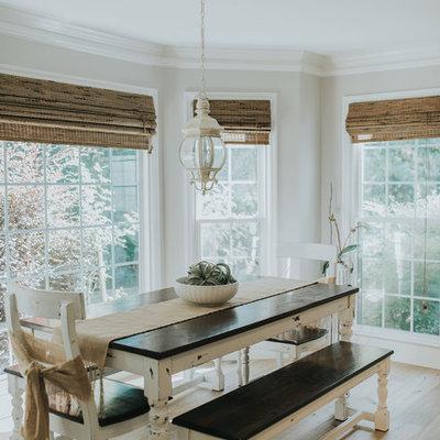 Example of a beach style medium tone wood floor and brown floor dining room design in Atlanta with beige walls