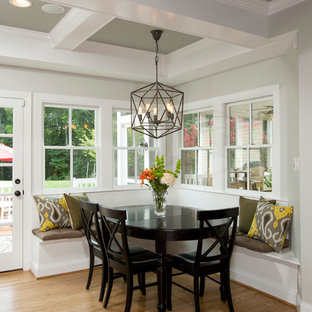 Inspiration for a farmhouse medium tone wood floor kitchen/dining room combo remodel in DC Metro with gray walls